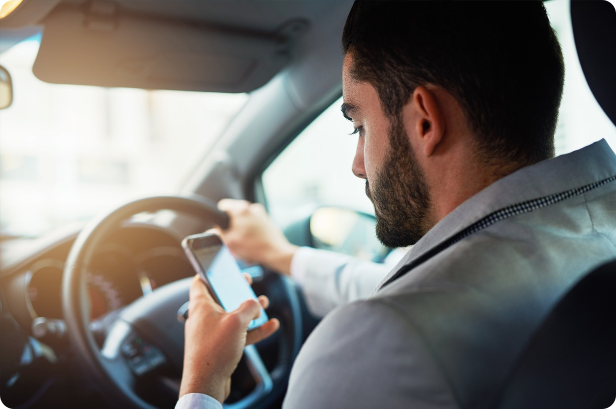 You can't use any type of mobile while you're driving