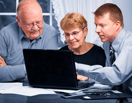 People looking at life insurance on laptop