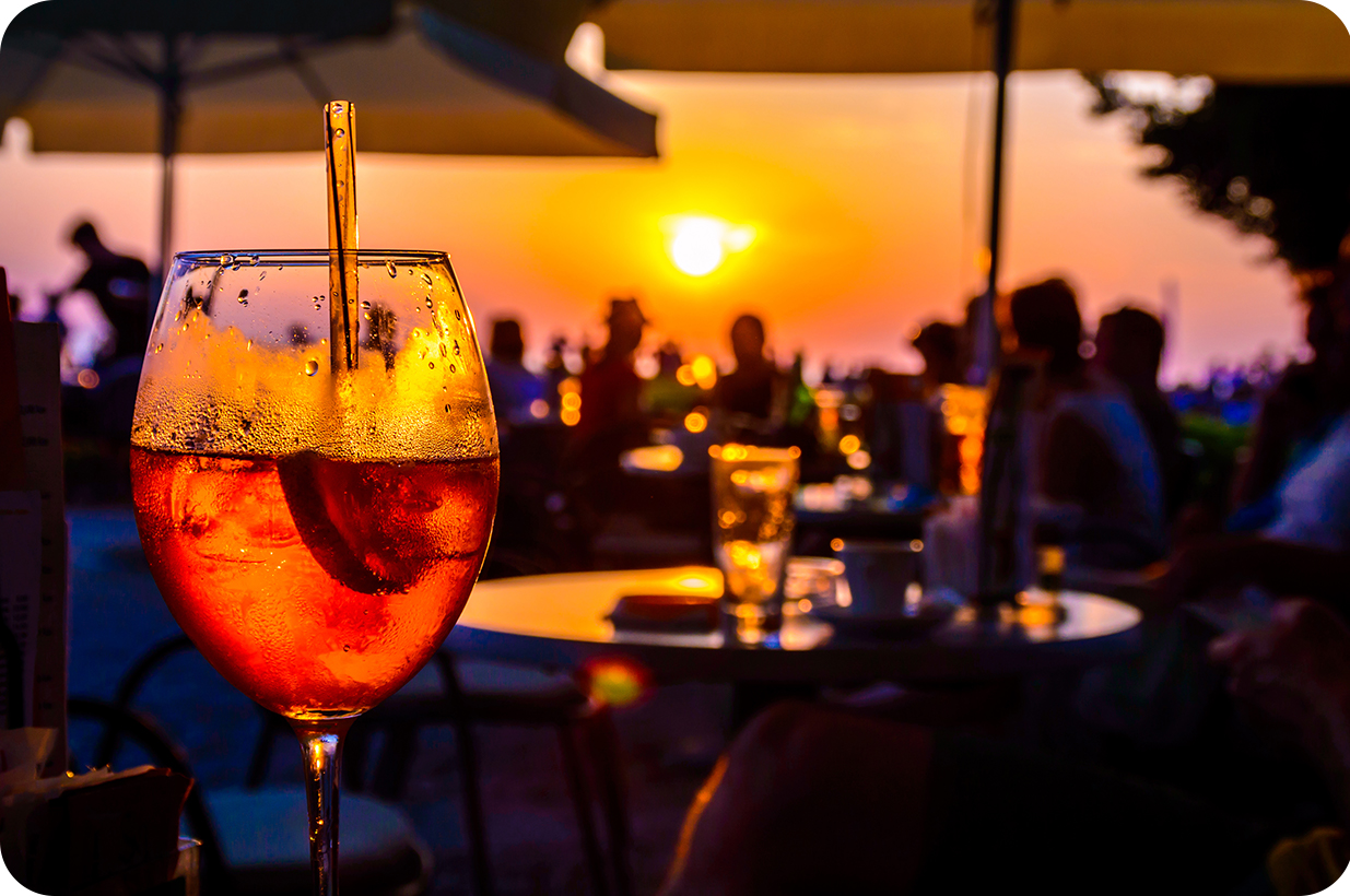 Drinking a glass of wine in the sunset | Compare the Market
