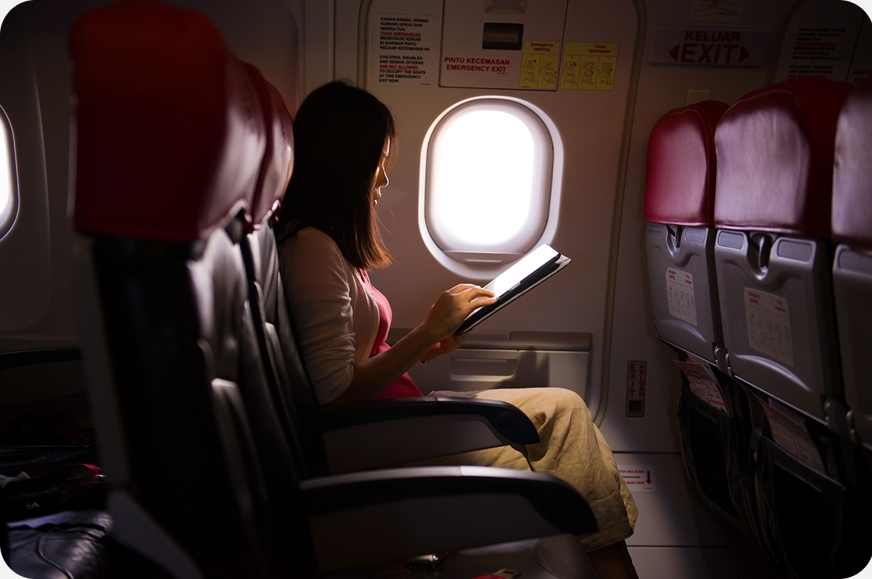 an individual sitting on the plane alone | Compare the Market