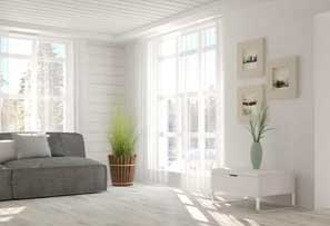 Living room with white walls and a grey sofa
