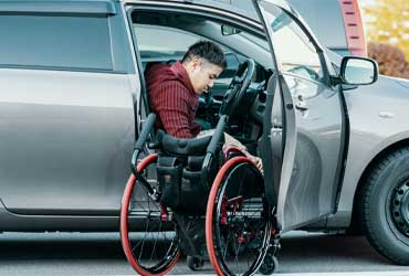 A driver getting into a wheelchair