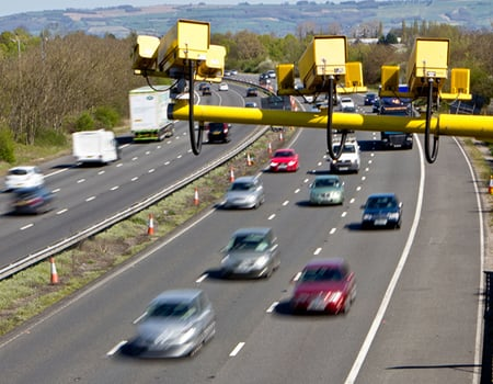 ANPR cameras monitoring cars driving on a motorway