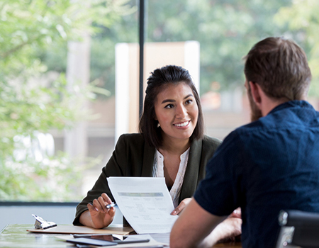 A person meeting with a financial adviser