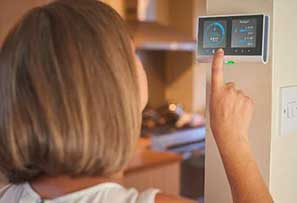 Changing thermostat in office