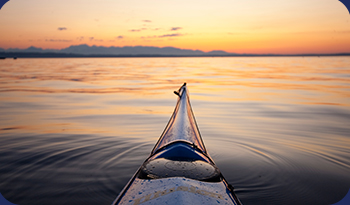 Canoe on the lake in the sunset | Compare the Market