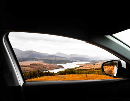 Car window with a mountain view