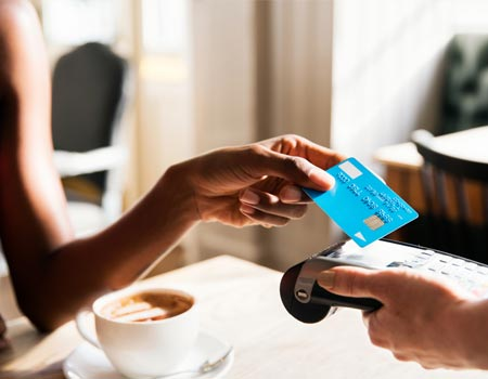 Paying for a coffee with a credit card
