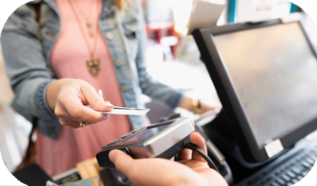 An individual paying at the till via contactless | Compare the Market