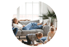 Children in a living room with parents