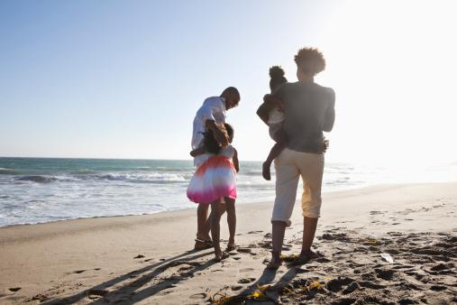 Family wth children on the beach