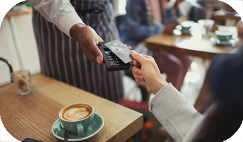 An individual paying for their coffee | Compare the Market