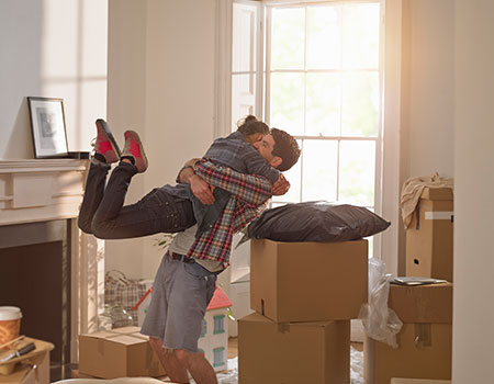 Couple celebrating moving into first home together