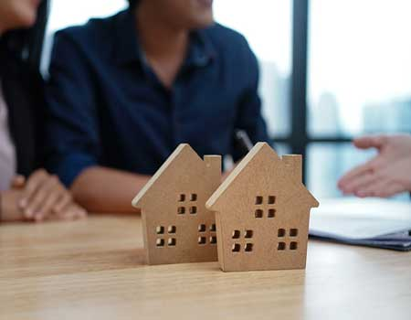 Couple meeting with a mortgage adviser