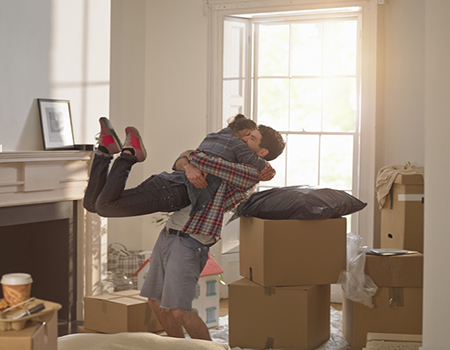 Couple celebrating moving into new home