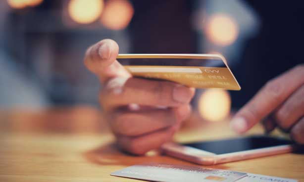Using a credit card and mobile phone