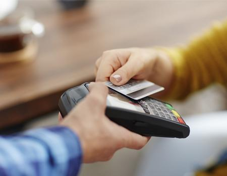 Person paying by card