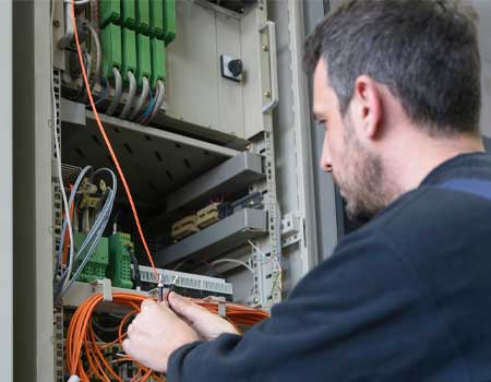 Engineer connecting fiber optic cable
