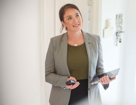 Woman checking round clients home