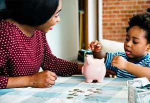 Mother and child counting money together