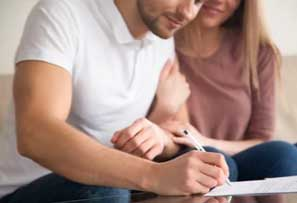 People signing a mortgage paper