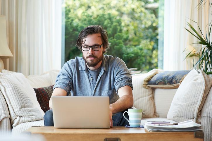 Man searching for loans on computer