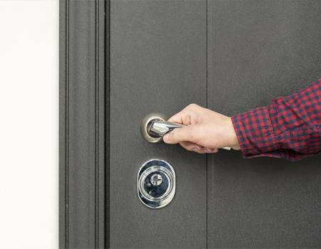 Locking a door before going out