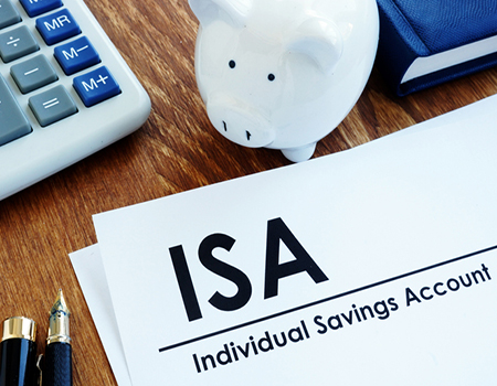 ISA paperwork next to a piggy bank and calculator
