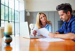 Couple looking at paper documents