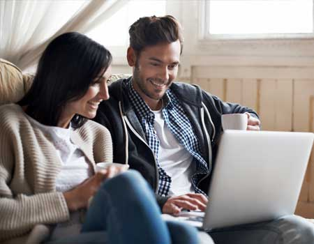 Couple together on a laptop