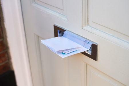Letter going through letterbox