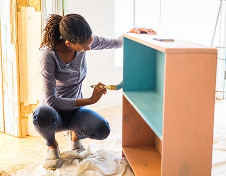 Lady renovating furniture