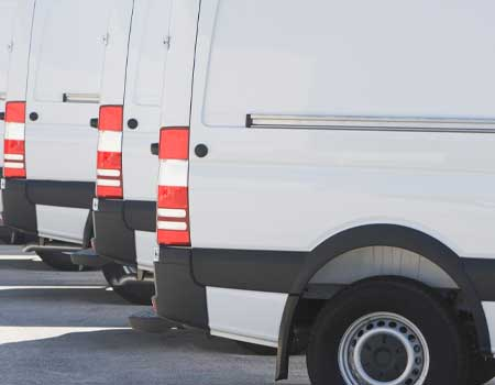 A rear view of vans lined up