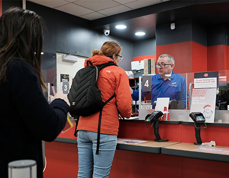 Person being served at the post office