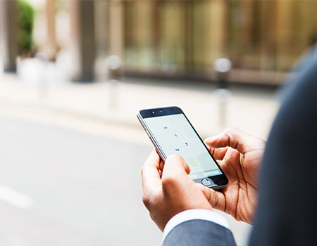 Person using mobile app to book taxi