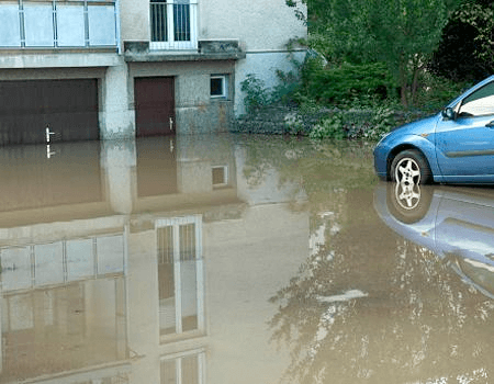 Car and house in a flood