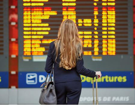 Person looking at departures board