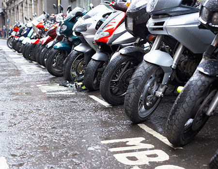 Row of motorbikes parked in the street