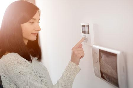 Person preparing home security before going on holiday