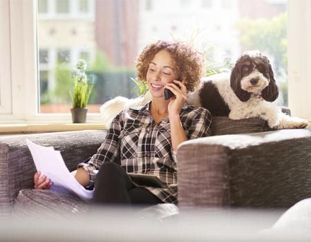 Person on phone in living room