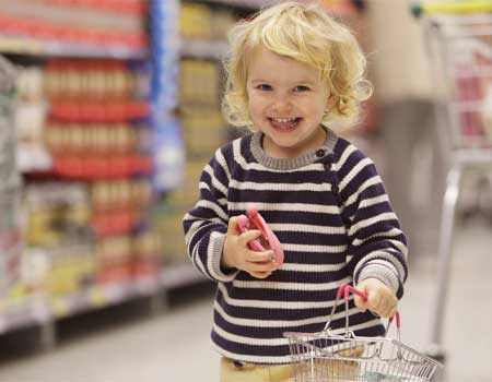Toddler with shopping basket and purse