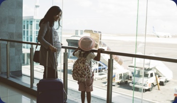 A mother and daughter at the airport | Compare the Market