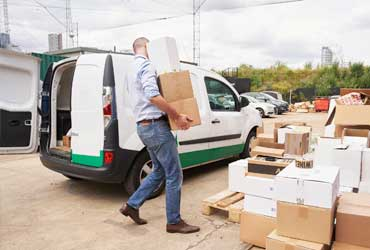 Man unloading van full of parcels