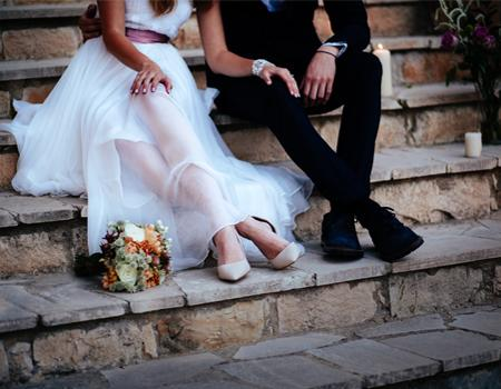 Bride and groom sat on the steps