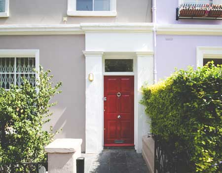 Red front door of a house