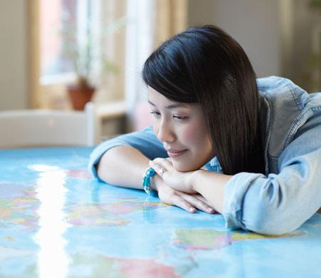 Looking at a map to determine next destination to go on holiday