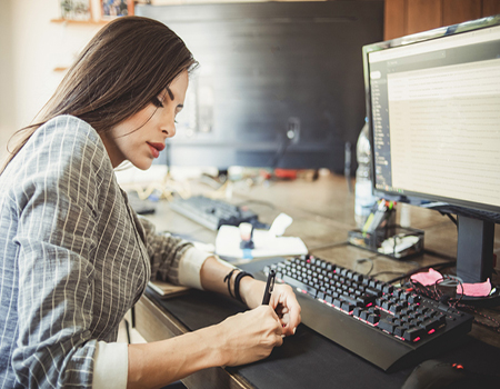 Woman working in an office using a computer