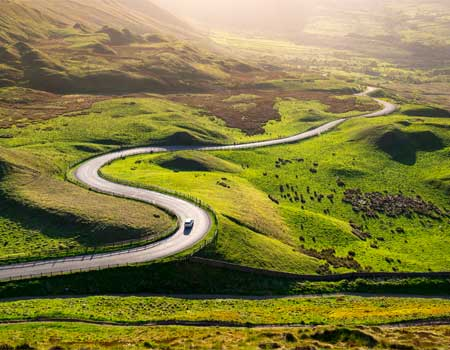 A car driving on a winding road
