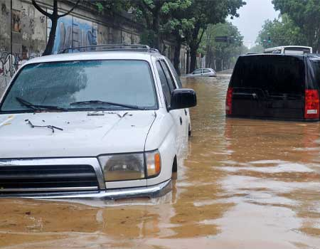 Cars parked in a flooded stret
