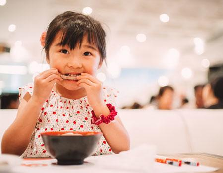 Child eating at restaurant
